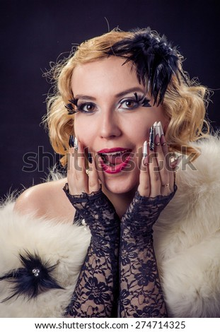 Retro portrait of beautiful wondering happy blonde wondering smiling woman with jewels and extreme long nails. Gatsby, Vintage style. Isolated on black background