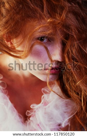 Retro portrait of red-haired queen like girl. studio shot