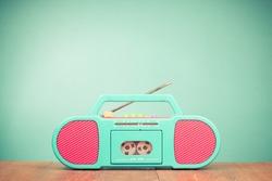 Retro radio cassette recorder front mint green background