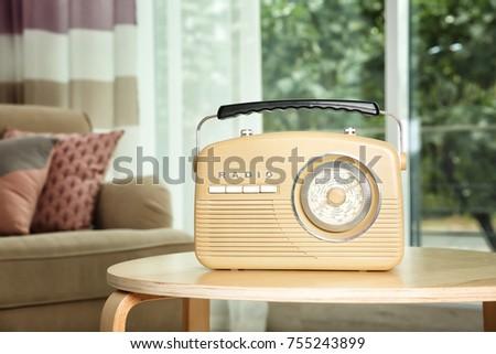 Retro radio on table #755243899