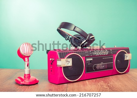 Retro radio recorder microphone and headphones front mint green background