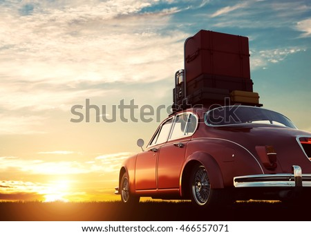 retro red car with luggage on...