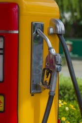 Retro red fuel pump old yellow