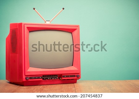 Retro red old television front mint green background #207454837