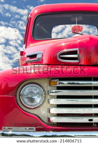 retro red truck with red fuzzy dice
