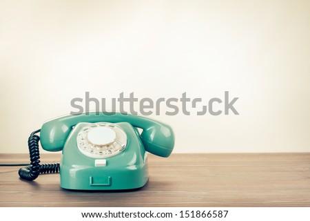 Retro rotary telephone on wood table #151866587