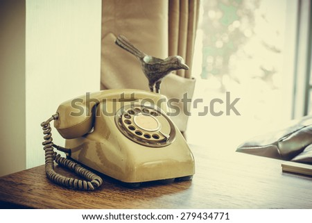 Retro rotary telephone on wood table #279434771