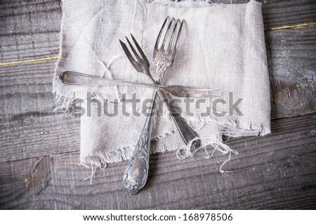 Retro silverware on gray napkin.