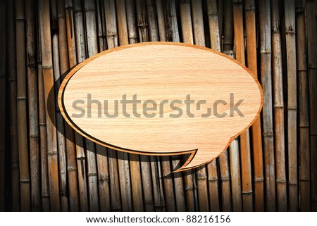 Retro speech bubbles from splat on bamboo wall background