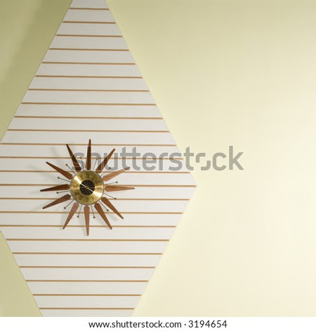 retro star shaped clock hanging on wall stock photo