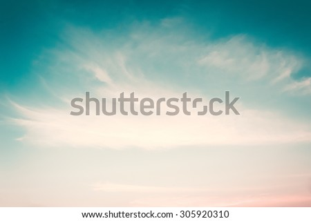 Retro style blurred sky background soft clouds on wind movement: Blurred nature background of cyan blue cloudy sky in vintage color tone
