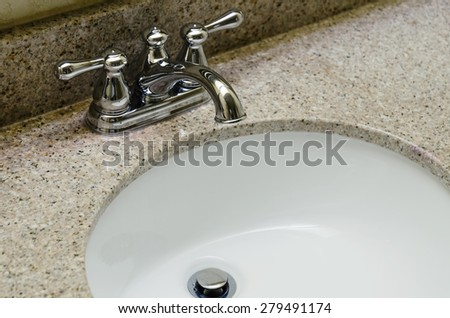 Retro style Chrome Faucet and old sink in bathroom. Selective focus on a tap