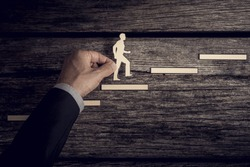 Retro style image of a successful businessman climbing the corporate ladder using paper cutouts.