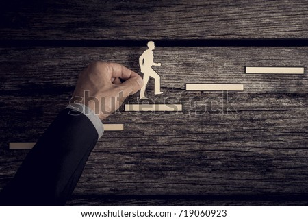 Retro style image of a successful businessman climbing the corporate ladder using paper cutouts. #719060923