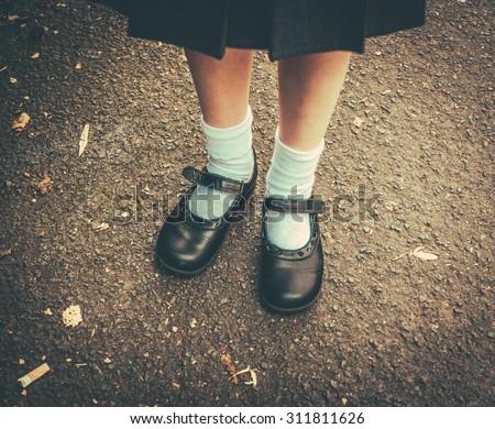 Retro Style Image Of School Girl\'s Feet In Uniform