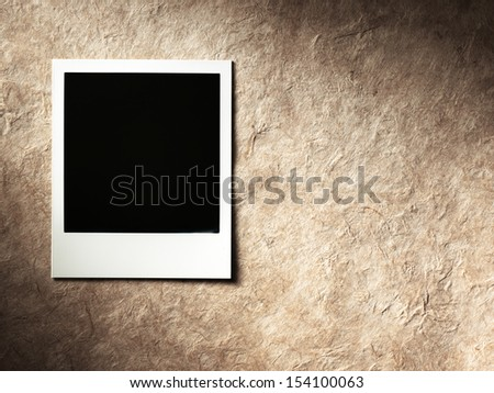 retro style photo frame on cardboard