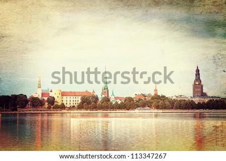Retro style photo of night Riga cityscape. Latvia