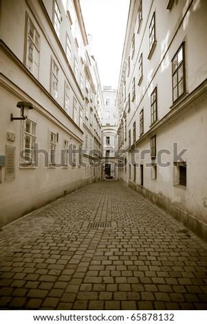 Retro style photo of old european town street