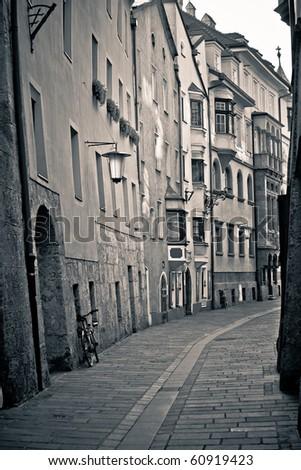 Retro style photo of typical european old town street. Innsbruck, Austria