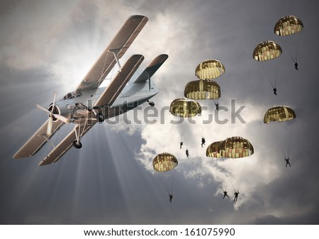Retro style picture of the biplane with skydivers