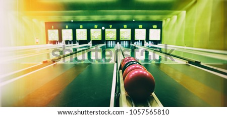 Retro style picture of the Ninepin bowling balls. Picture is deliberately a bit grainy and has light leaks. - Shutterstock ID 1057565810