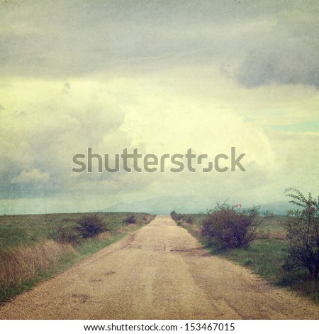 retro style picture with road and clouds