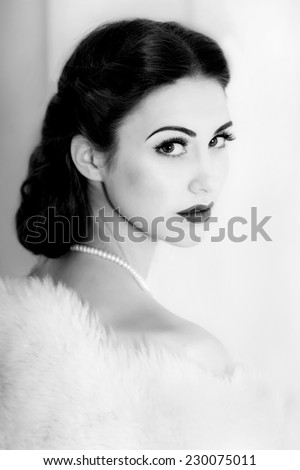 Retro style portrait of attractive young model with sad facial expression.  Black and white portrait.