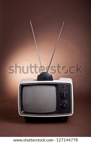 Retro style 70's TV set  with bunny ear antenna