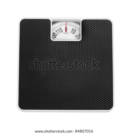 Retro style weighing machine isolated on a white background.
