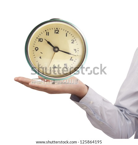 Retro-styled alarm clock in the arm of a businessman isolated on white background