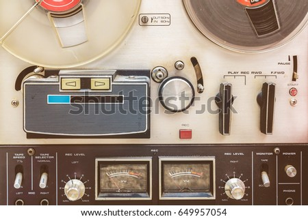 Retro styled close up of a vintage tape recorder #649957054