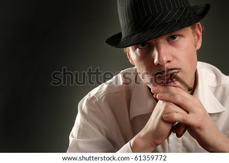 retro-styled gangster smoking cigar - stock photo
