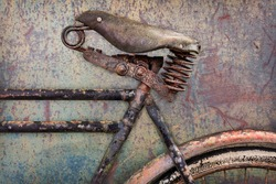 Retro styled image of a rusted ancient bicycle with leather seat