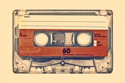 Retro styled image of an old compact cassette with empty label