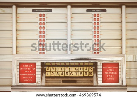 Retro styled image of an old jukebox with empty music labels #469369574