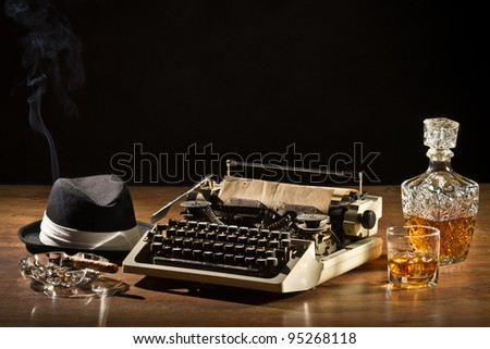 Retro-Styled old typewriter, cigar, hat and whisky with carafe