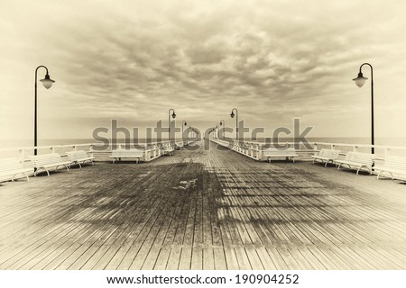 Retro-styled postcard of the pier - purposeful noise for neither reality pics