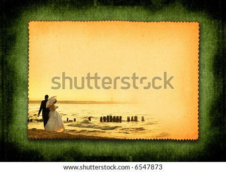 retro styled postcard with just married couple during beach stroll, large copy space for your content, photo inside is my property - stock photo