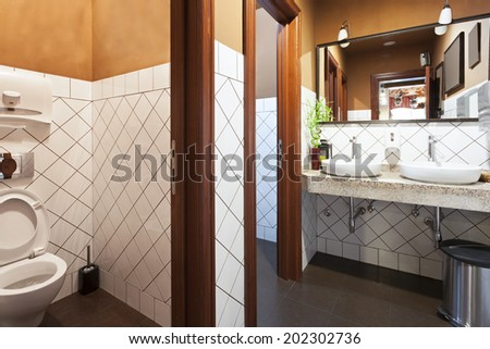 Retro styled public restaurant toilet #202302736