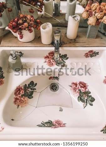 Retro styled public restaurant toilet with beautiful flowers candles in vintage style ussr Georgia Tbilisi