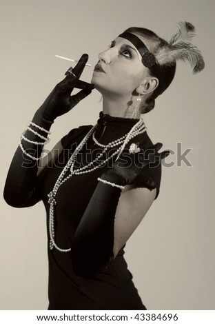 Retro styled sepia fashion portrait of a young woman. Clothing and make-up in 1920s style. - stock photo