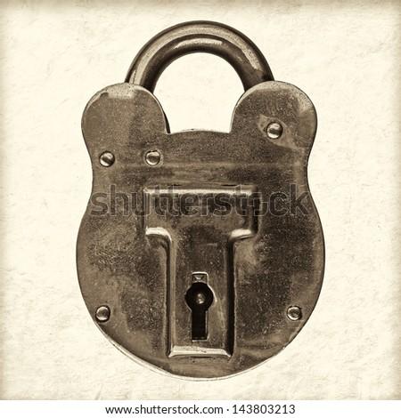 Retro styled sepia image of an antique brass padlock