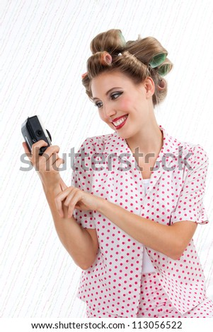 Retro styled woman taking self portrait with 35mm point and shoot camera