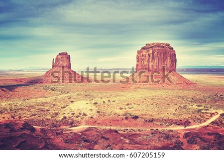 Retro stylized picture of Monument Valley at sunset, USA.