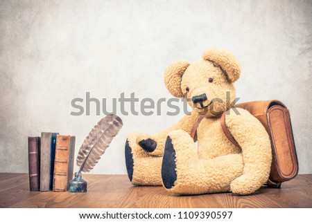 2c9f83f601623 Retro Teddy Bear toy with leather school bag near quill pen in the inkwell  and old