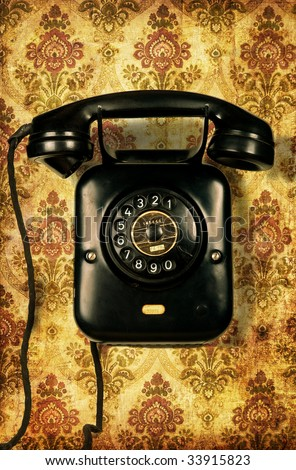Retro telephone on retro wallpaper