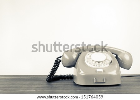 Retro telephone with empty place for vintage background #151764059
