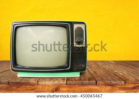 Retro television - old TV on wood table, vintage technology #450065467