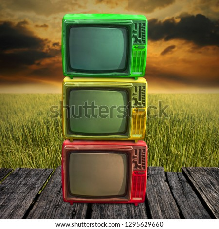 Retro television overlap on wooden deck with farmland background #1295629660