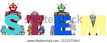 retro tin robot toys hold up the acronym STEM solated on white #1122571661